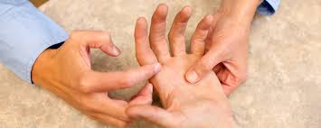 hand therapist helping with pain